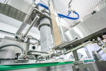 put pressure: Production of white stick ice-cream conveyor at factory