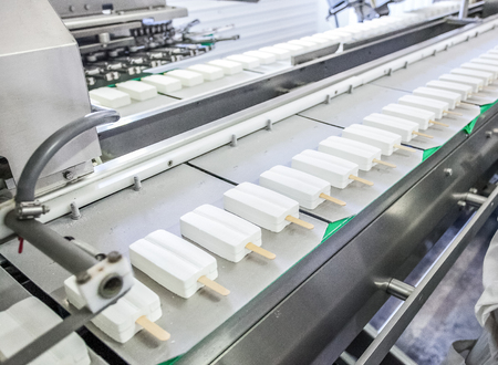 put pressure: conveyor production of white stick ice-cream at factory