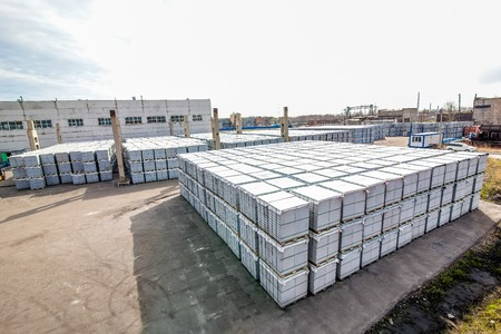 housebuilding: Stack of aerated concrete blocks - slabs outside near a house-building factory workshop Stock Photo