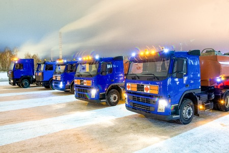 trucks for dangerous materials at winter outside at night