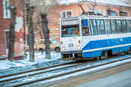 motor de carro: Omsk, Russia - March 21, 2013: blue tram rides on rails at winter Editorial