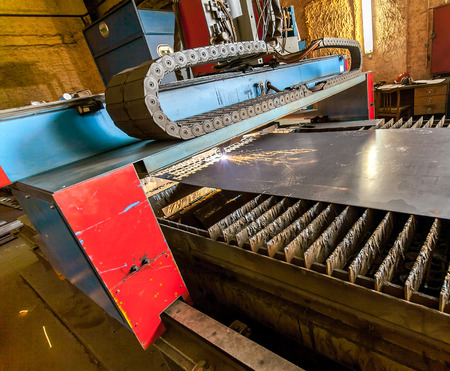 affixment: working metal cutting machine at factory close up Stock Photo