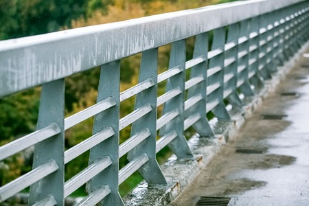 guardrails: pedestrian zone on the car bridge with guardrails at rainy day Stock Photo