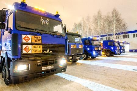 liquids: Omsk, Russia - December 6, 2011: Gazprom, trucks for transportation of dangerous liquids, Gasoline tanker at night Editorial