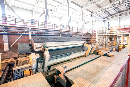 conveyor rail: Production of aerated concrete blocks at bright new factory Stock Photo