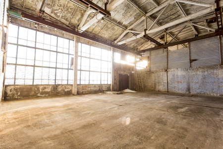 abandoned room: abandoned emoty room in an old factory at sunny day