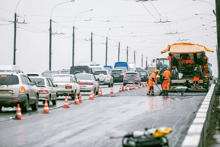 heavy equipment operator: Omsk, Russia - August 19 , 2013: traffic on the road, road repairs Editorial