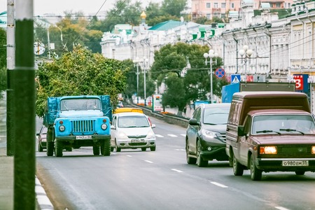 Omsk, Russia - August 19 , 2013: traffic on the road, car motion close up