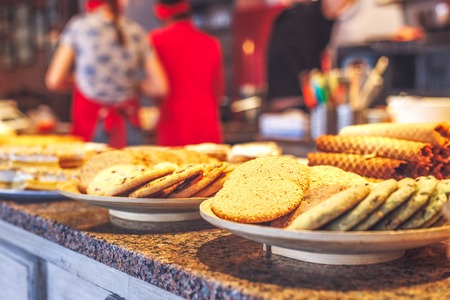 kinds: different kinds of homemade cookies on white plates