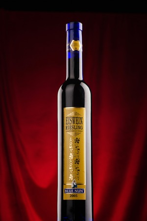 riesling: Omsk, Russia - August 14, 2014: Blue Nun, Eiswien Riesling, bottle of red vine on the bar counter Editorial