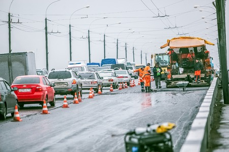 road surface: Omsk, Russia - August 19 , 2013: traffic on the road, road repairs Editorial