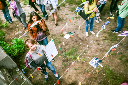above 21: Omsk, Russia - May 21, 2014: Festival of Photography in street, people watching view from above Editorial