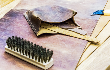 saddler: leather workshop and tools on wodden table Stock Photo