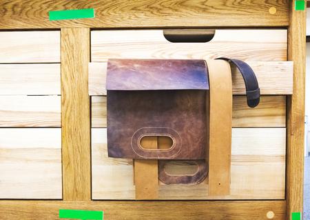 wooden beams: leather brown blanks bag hanging on wooden beams