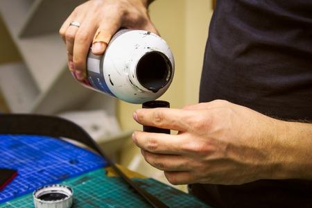 saddler: leather workshop colorant preparation and tools  on background