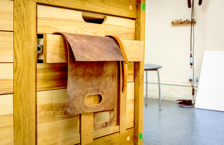 blanks: leather brown blanks bag hanging on wooden beams
