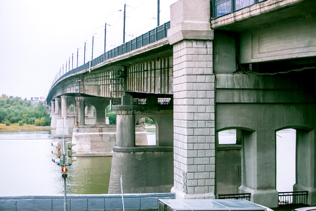 concrete structure: concrete gray bridge over the city river