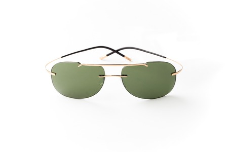 unisex: unisex sunglasses with brown lens isolated against a white background