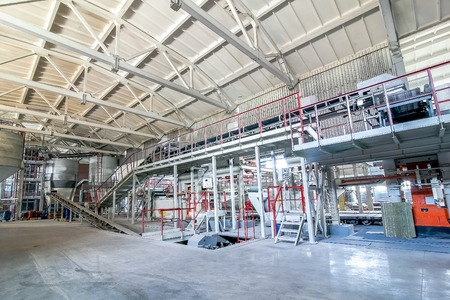 Concrete mixing tanks with transporter inside factory