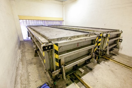 conveyor rail: Production of aerated concrete blocks in metal box at bright new factory