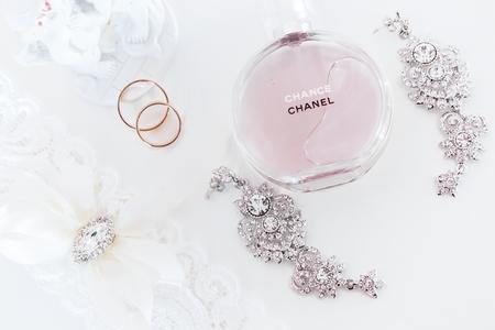 chanel: Omsk, Russia - June 03, 2014: bride morning  perfume Chanel, garter, earrings and wedding rings
