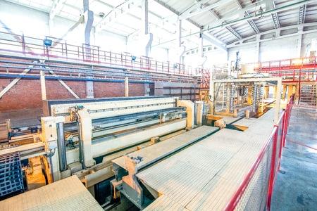 regulators: Modern machinery equipment at factory producing concrete blocks