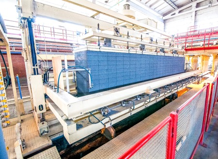 conveyor rail: Production process of aerated concrete blocks on a factory block moving on rail