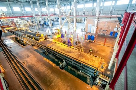 heavy equipment operator: Production of aerated concrete blocks at bright new factory production facilities ready for use