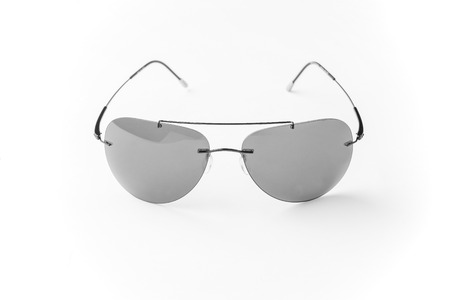 unisex: unisex sunglasses with gray  lens isolated against a white background