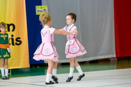 irish ethnicity: Omsk, Russia - August 22, 2015: International  competition of irish dance, little girls dancing