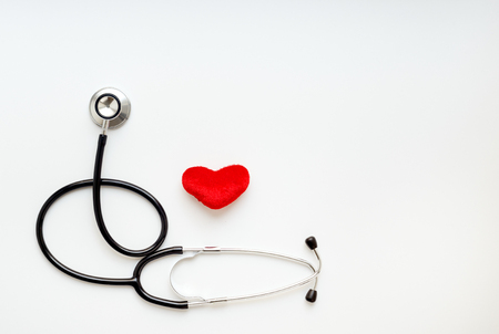 stethescope: stethoscope on a white background with plush red heart Stock Photo