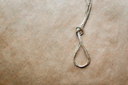 gibbet: concept hangmans knot on kraft paper backgroun close up
