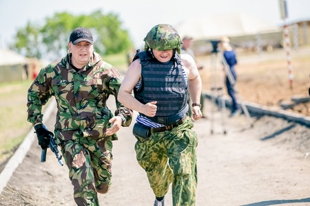 unite: Omsk, Russia - July 1, 2015: military training, riot police unite - Omon -  in Omsk, running