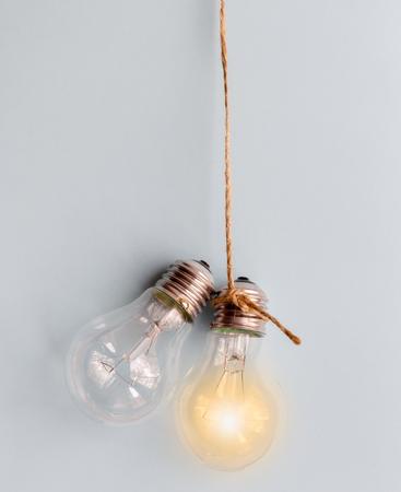lit lamp: concept of idea illustration lit lamp on gray background close up