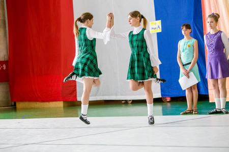 irish ethnicity: Omsk, Russia - August 22, 2015: International  competition of irish dance, girls dancing