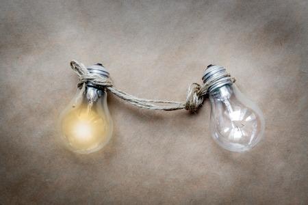 lit lamp: concept of idea illustration lit lamp on paper background close up