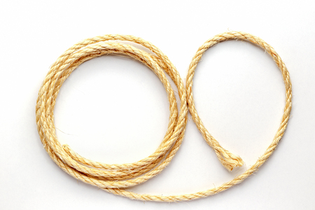 cable knit: twisted rope on a white background close up isolated