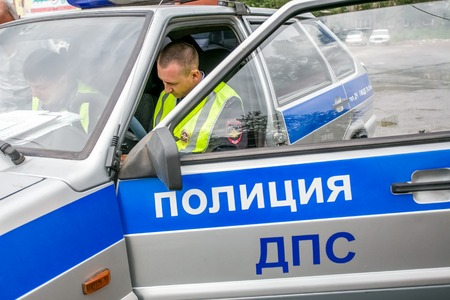 raid: Omsk, Russia - July 10, 2015: traffic police raid in Omsk - police car