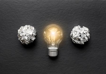 lit lamp: concept of idea illustration lit lamp on black background close up