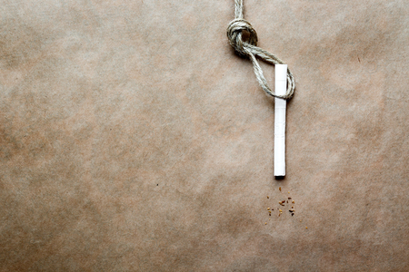 capital punishment: concept hangmans knot on paper background with cigarette close up