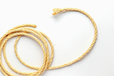 coiled: coiled rope on a white background close up isolated