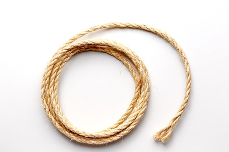 coiled rope: coiled rope on a white background close up isolated