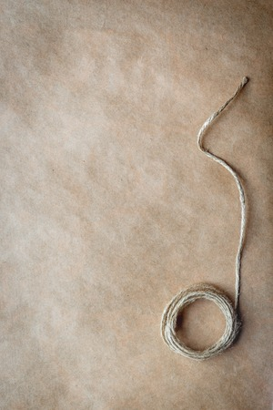 twined: skein of twine on a background at kraft paper close up Stock Photo