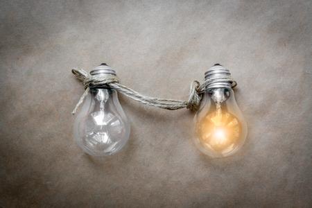 lit lamp: concept of idea illustration lit lamp on kraft paper background close up