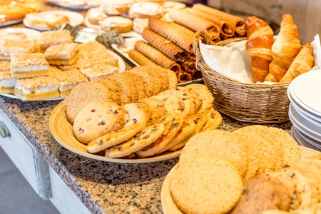sweet pastries: different types of sweet pastries on white plates