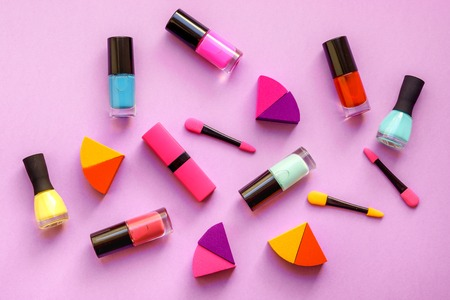 lifestyle shopping: concept cosmetic set on pink background top view. Stock Photo