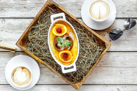 Sweet dessert with coffee on the wooden table top view