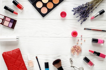 cosmetic set on white table with lavender top view.