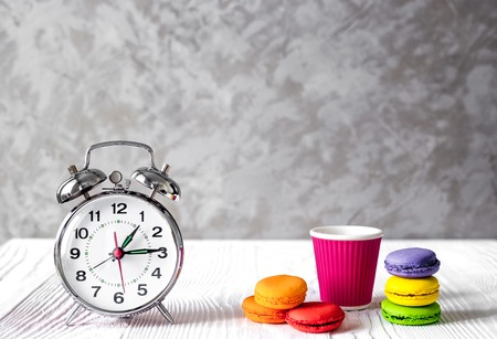 seconds: alarm clock time to drink coffe on white background