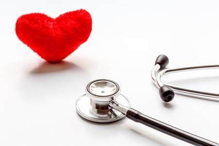 plush: stethoscope on a white background with plush red heart Stock Photo